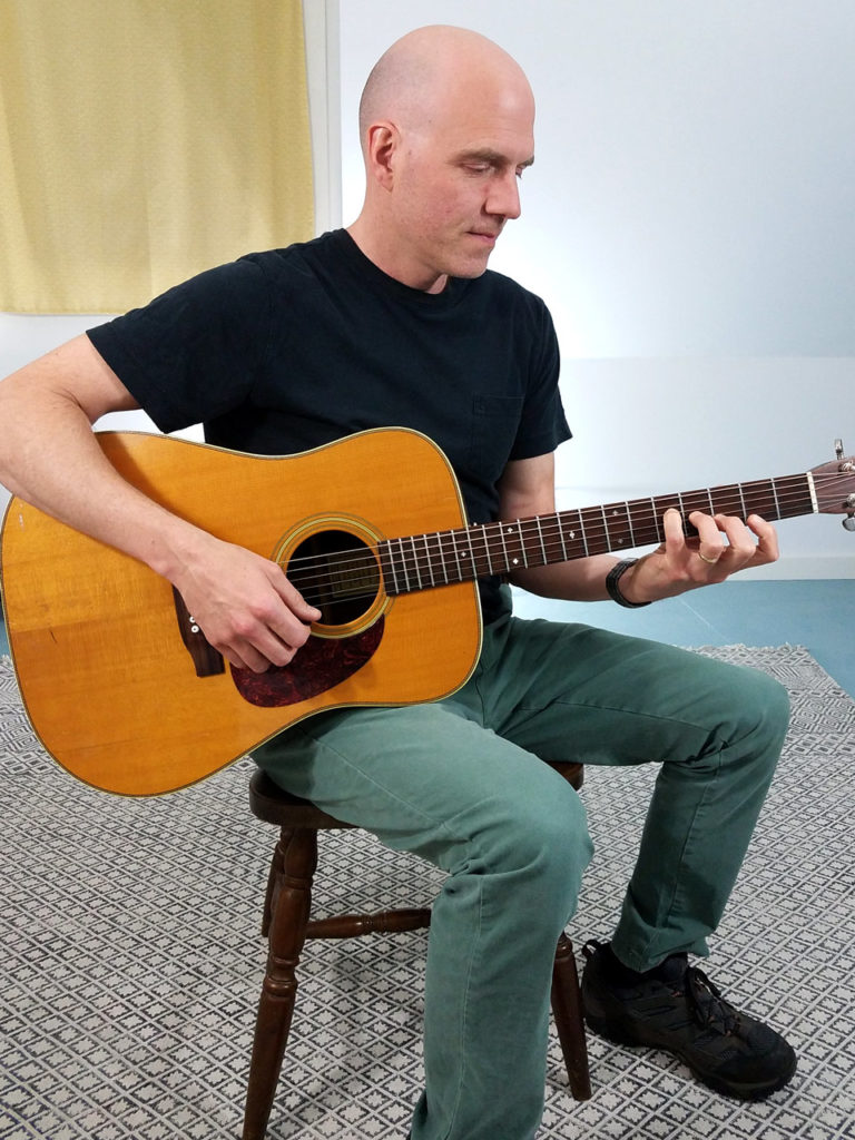 Correct posture when holding the guitar