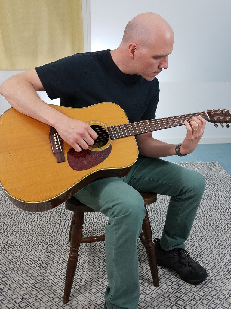 Bad posture when holding the guitar