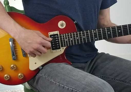 Holding electric guitar